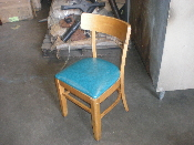 Used wooden chair with cushion
